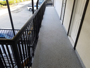 Duradek and new railings for the Timberlodge Hotel in Port Alberni